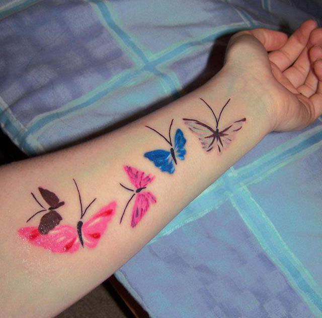 butterfly-tattoo-designs-neon-inked-butterflies-arm-tattoo-design